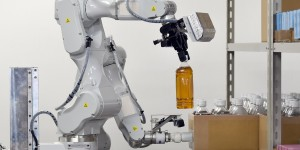 A prototype robot with two arms, which was developed by Japan's comprehensive electrical machinery manufacturer Hitachi for distribution warehouses, demonstrates its abilities during a demonstration for the media at a warehouse in Noda, in suburban Tokyo, on August 25, 2015. The robot can move to a location, take items off shelves and put them into boxes automatically, in place of employees.    AFP PHOTO / Toru YAMANAKA